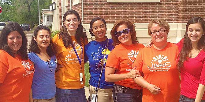 Romina Barral (3rd. from left to right) with members of Juntos Center.